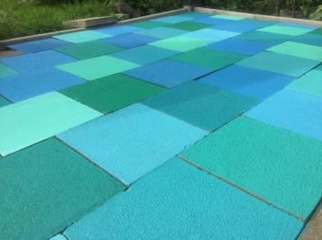Schnöde Betonplatten in karibischen Farben